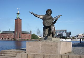 Stockholm city hall and the statue of Evert Taube